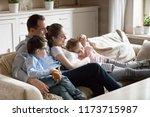 happy parents hug kids lying on ... | Shutterstock . vector #1173715987