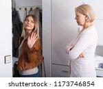 the elderly mother escorts her... | Shutterstock . vector #1173746854