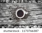 coffee mug with coffee beans on ... | Shutterstock . vector #1173766387