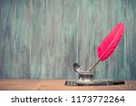 quill ink pen with old inkwell... | Shutterstock . vector #1173772264