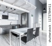 gray kitchen with white dining...   Shutterstock . vector #1173784411