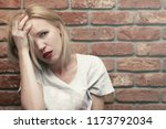 a woman with a sad  suffering... | Shutterstock . vector #1173792034