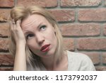 a woman with a sad  suffering...   Shutterstock . vector #1173792037