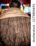 Small photo of Ivolginsky Datsan, Ulan Ude, Siberia, Russia - March 24, 2018: Buryat buddist monk's backside view when he is reading mantra at the Dzogchen Dugan in Ivolginsky Datsan, Siberia, Russia.
