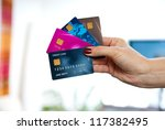 woman hand holding various credit cards