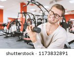 funny weak man tries to lift a... | Shutterstock . vector #1173832891
