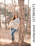 pregnant woman wearing cozy... | Shutterstock . vector #1173842671
