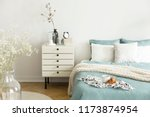 a bright bedroom interior with... | Shutterstock . vector #1173874954