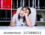 bored  little schoolgirl doing... | Shutterstock . vector #1173888211