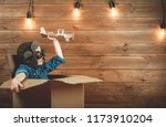 child is playing in aviator in... | Shutterstock . vector #1173910204