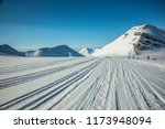 a sunny day skiing in svalbard | Shutterstock . vector #1173948094
