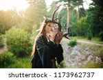 a girl in a terrible mask with... | Shutterstock . vector #1173962737