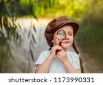 little girl with magnifying.... | Shutterstock . vector #1173990331