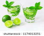 a cocktail of mint and lime on... | Shutterstock . vector #1174013251