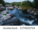 stones and bubbling river | Shutterstock . vector #1174023724