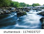 stones and bubbling river | Shutterstock . vector #1174023727