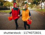 happy kids in halloween costume ... | Shutterstock . vector #1174072831