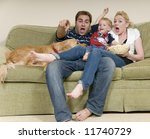 young family watching movie at... | Shutterstock . vector #11740729