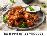 barbecue boneless chicken wings ... | Shutterstock . vector #1174099981