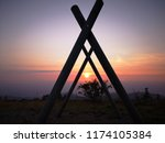 sunset seen through a swing set ... | Shutterstock . vector #1174105384