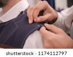 tailor working on custom made... | Shutterstock . vector #1174112797