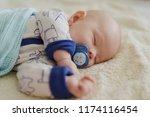 newborn with dummy sleeping on... | Shutterstock . vector #1174116454
