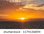 dramatic golden sky at the... | Shutterstock . vector #1174136854