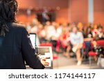 female speaker giving a talk on ... | Shutterstock . vector #1174144117