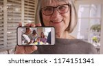 grandmother showing off footage ... | Shutterstock . vector #1174151341