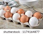 a carton of organic cage free... | Shutterstock . vector #1174164877