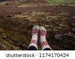 legs in socks with beautiful... | Shutterstock . vector #1174170424