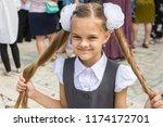 schoolgirl at the festival on... | Shutterstock . vector #1174172701