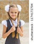 portrait of a schoolgirl on the ... | Shutterstock . vector #1174172704