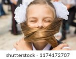 the schoolgirl on a holiday on... | Shutterstock . vector #1174172707