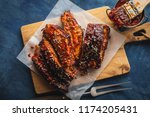 smoked roasted pork ribs over... | Shutterstock . vector #1174205431