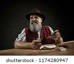 The Senior Bearded Man Sitting...