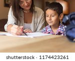 the mother and son sit at the... | Shutterstock . vector #1174423261