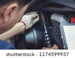 hand of mechanic check and... | Shutterstock . vector #1174599937