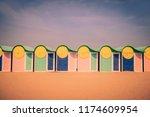 beach cabins in dunkirk.... | Shutterstock . vector #1174609954