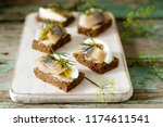 Stock photo tradition danish open sandwich smorrebrod with herring egg mustard and dill dark bread sandwich 1174611541