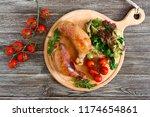 tasty stuffed chicken legs with ... | Shutterstock . vector #1174654861