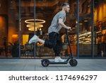 attractive man riding a kick... | Shutterstock . vector #1174696297