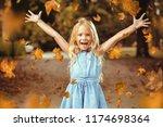 happy little girl in autumn... | Shutterstock . vector #1174698364