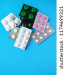 different pills on blue... | Shutterstock . vector #1174699321