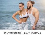 young athletic tourist couple... | Shutterstock . vector #1174708921