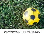 yellow soccer ball on the green ... | Shutterstock . vector #1174710607