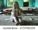 the girl in the destroyed... | Shutterstock . vector #1174782154