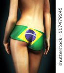 Erotic woman wearing Brazil shorts - stock photo