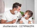 father and son having fun while ...   Shutterstock . vector #1174966294