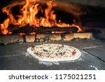 pizza preparations in a self... | Shutterstock . vector #1175021251